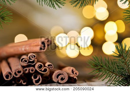Christmas Background with Cinnamon and Christmas Twig.