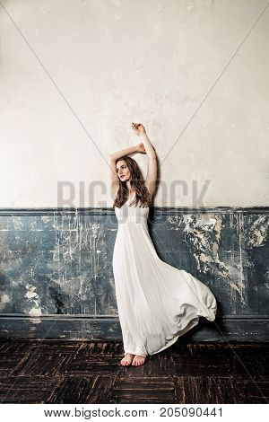 Perfect Woman in White Dress. Glamourus Beautiful Fashion Model on Vintage Background