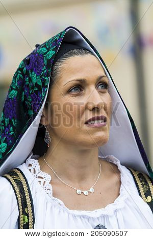 SELARGIUS, ITALY - SEPTEMBER 10, 2017: 57 Edition of the Old Marriage Selargino - Portrait of a beautiful woman wearing a traditional Sardinian costume - Sardinia