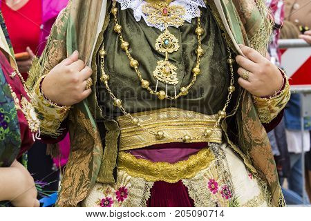 SELARGIUS, ITALY - SEPTEMBER 10, 2017: 57 Edition of the Old Marriage selargino - detail of a traditional Sardinian costume - Sardinia