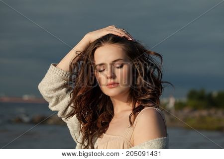 Outdoors Portrait of a Beautiful Model Woman with Long Brown Hair Outdoors