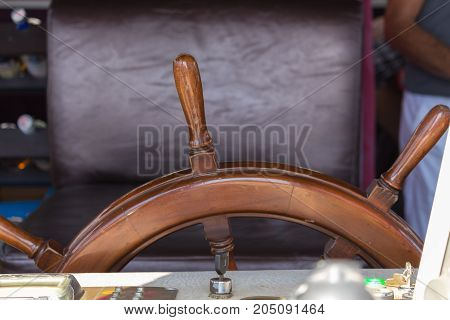 Ship steering wheel on a yacht at seShip steering wheel on a yacht at sea. The wheelhouse of the ship going to the Mediterranean. The bridgea