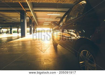car in underground parking looking for spot