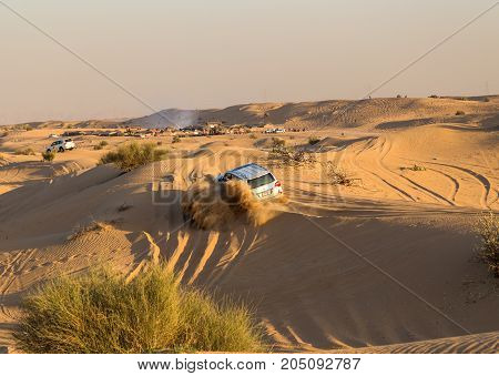 DUBAI UNITED ARAB EMIRATES - JANUARY 25 2016: Safari rally off-road car 4x4 adventure driving in the desert sand dune is a popular activity among tourists in Dubai.