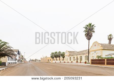 SWAKOPMUND NAMIBIA - JUNE 30 2017: A street scene with the Hotel Prinzessin Rupprecht and the Kaserne building in Swakopmund in the Namib Desert on the Atlantic Coast of Namibia