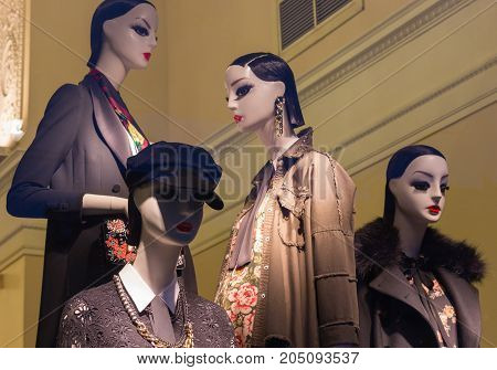 The window of a clothing store with mannequins in Saint Petersburg, Russia. Beautiful design, backlight, stylish clothing for shopping. Clothing for women and men