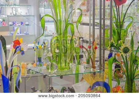 Flowers of glass and crystal. Souvenirs in St. Petersburg. Beautiful storefront colors of glass. Jugs and pots for flowers 3d glass flower
