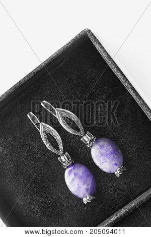 Amethyst vintage earrings with diamonds in black jewel box closeup
