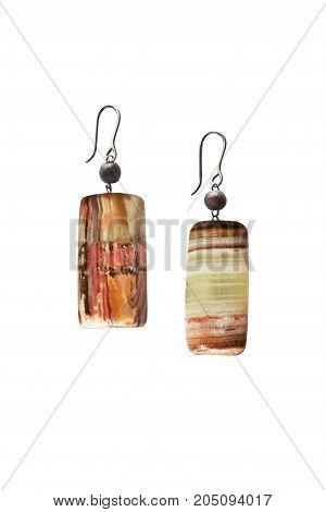 Pair of simple jasper earrings on white background