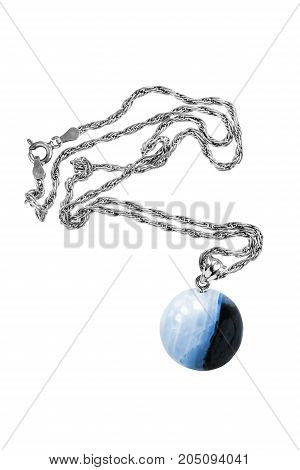 Blue mineral ball pendant on silver chain isolated over white