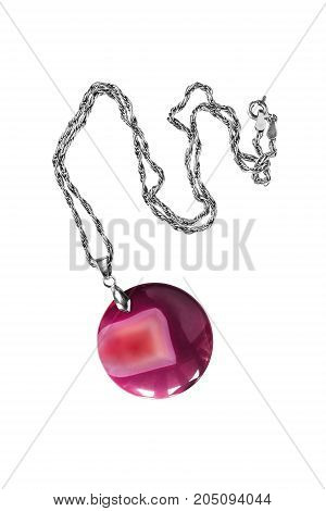 Round pink mineral pendant on a chain isolated over white