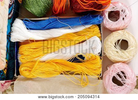 the several color spools of thread for embroidery
