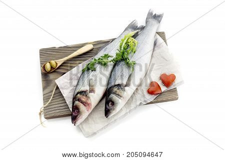 Two raw european bass (Dicentrarchus labrax) on a white background closeup