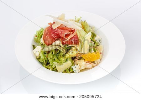 Restaurant food. Salad in a plate. Delicious food. Isolated on a white background. Cabbage Salad with bacon and cheese