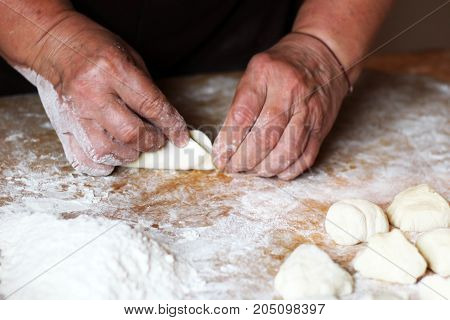 Female hands making dough for pizza food