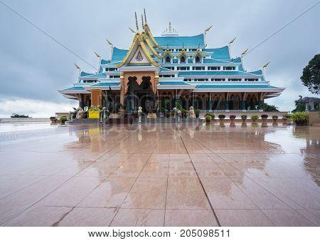 Wat Pa Phu Kon in rainy season with reflection Udon Thani Thailand