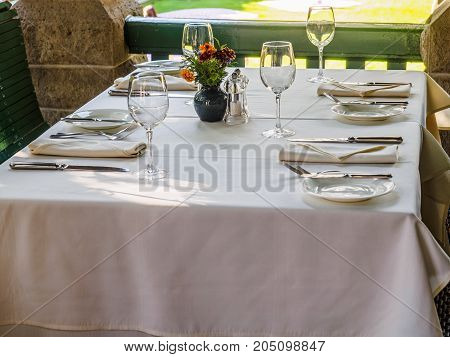 Table is set in a restaurant for a dinner