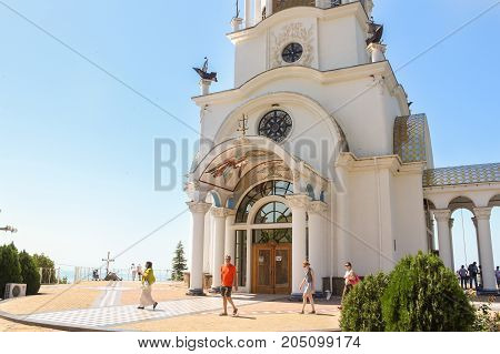 Yalta, Crimea - 11 July, People are at the white cathedral, 11 July, 2017. Temple on the Black Sea coast on the way to Sudak.