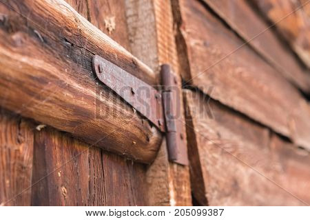 Close-up of a rusty canopy on an old wooden door in a small village