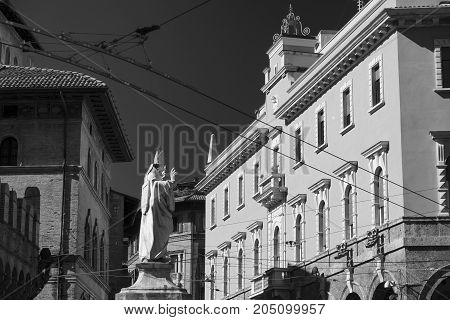 Bologna (Emilia Romagna Italy): historic buildings in a sunny morning. Black and white