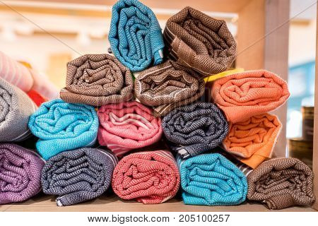 Colorful scarves, shawl or wrap at a store shelf. Colors of fashion textiles, A beautiful accessory complementing the image.