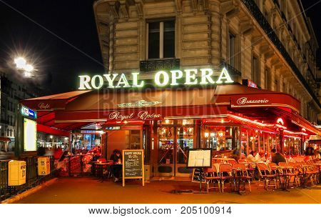 Paris, France - September 16, 2017: the traditional French cafe brasserie Royal Opera with unidentified people at night.