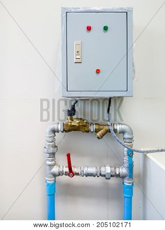 Electrical control box for water pumping in the public toilet of the small factory.