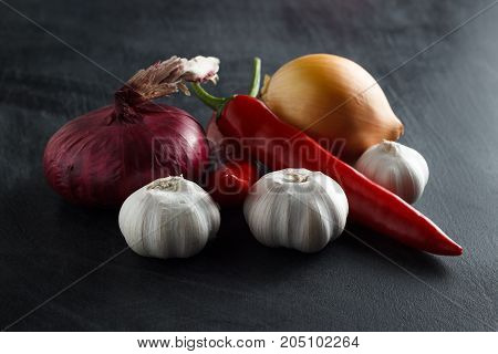 Vegetables Red And Yellow Onions With Red Pepper And Garlic
