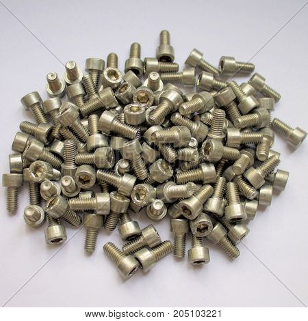 Bolt nut hardware industrial closeup construction fastener industry metal metallic.