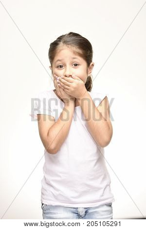 worried girl closing her mouth and white background