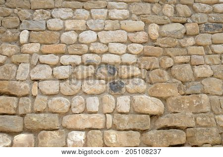 Stone wall of building in the medieval village of Besalu a town in the comarca of Garrotxa in Girona Catalonia Spain.