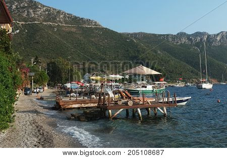 Marmaris, Turkey - August 16, 2017:  Scenery of small bay with jetty and boats in Marmaris, Turkey