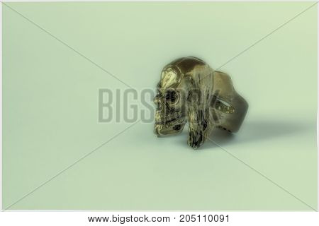 Silver Skull Ring On A Gray Background.
