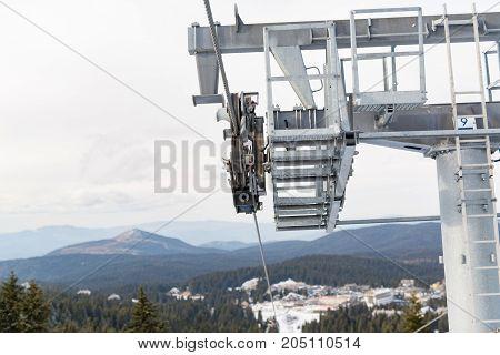 Top of a cable car lift at a ski resort.