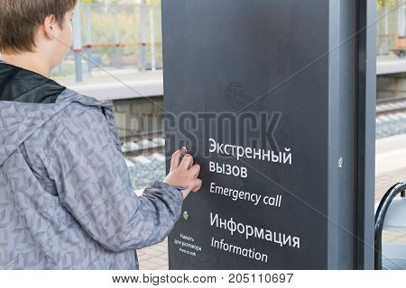 The teenager presses the emergency call button at the station