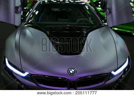 Sankt-Petersburg Russia July 21 2017: Luxury BMW i8 hybrid electric coupe. Plug-in hybrid sport car. Concept electric vehicle. Dark Matt colour. Car exterior details. Photo Taken at Royal Auto Show July 21