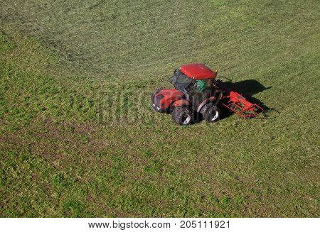 Small tractor in a field, view from above