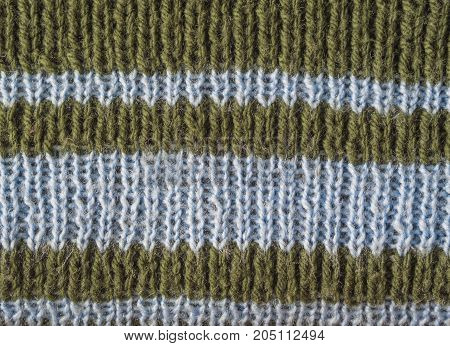 Olive Green Wool Hand Knitted Texture With Light Blue Stripes Abstract Background