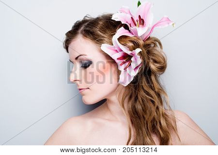 Close-up of beautiful girl with flowers On white background