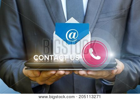 Businessman Showing Contact Us On The Tablet.