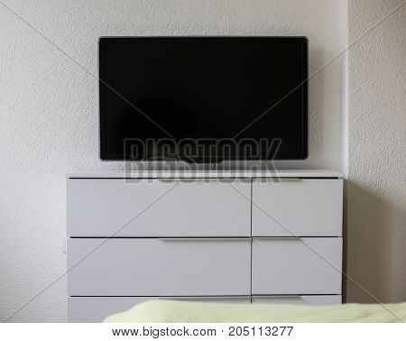 Modern Equipped Apartment, Plasma Tv On The Wall, White Stand Under The Tv, Interior Of The Apartmen