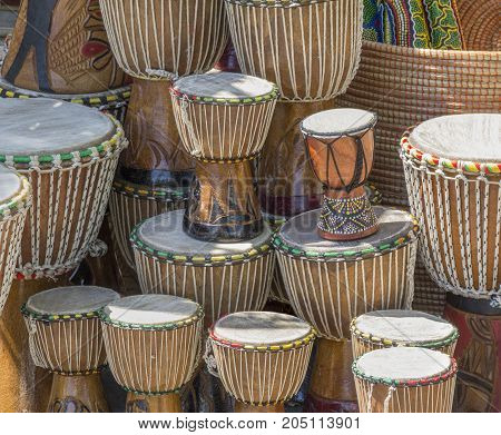 lots of african djembe drums in sunny ambiance
