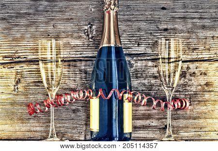 Champagne Bottle And Goblets.