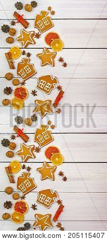 Festive ornament of spices nuts cones fruits berries homemade gingerbread. Christmas decor in a rustic style. Christmas background.