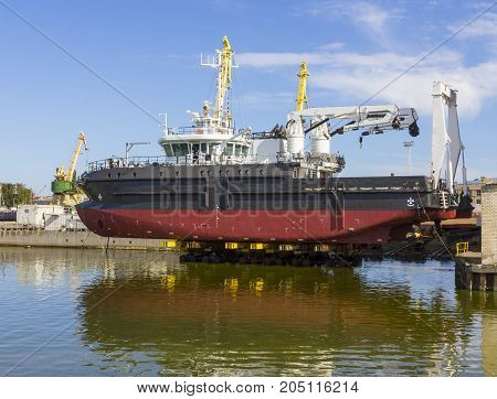 A large ship is ready to drop in water