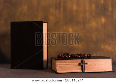 Bible on a wooden dark table. Beautiful gold background.Religion concept.