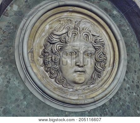 Istanbul Turkey - April 06 2016 an ancient medallion with the head of Medusa Gorgon on the wall of the museum of archeology real art editorial.