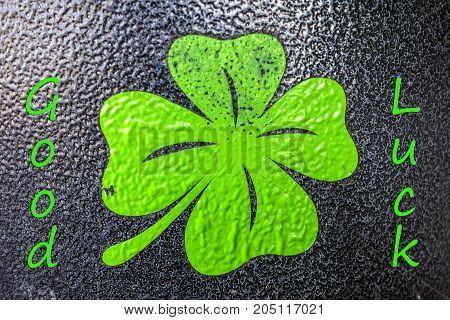 Four leaf clover with the inscription Good luck!