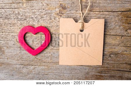 Heart Shape And Empty Card On Wooden Background