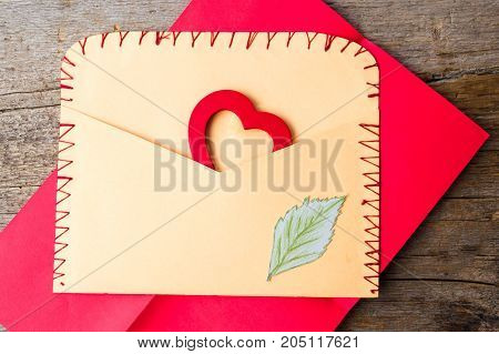 Envelope With A Heart Shape On A Wooden Background